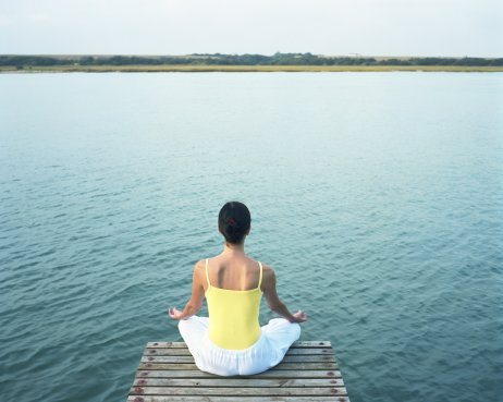 South Africa, Eastern Cape Province, woman on jetty in meditation